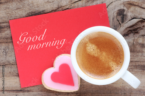 Cup of espresso coffee with a cookie and Good morning message
