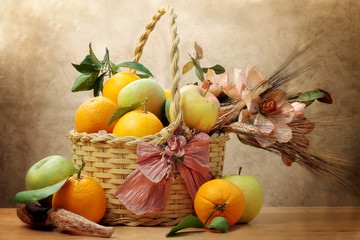 oranges and green apple inside wicker basket