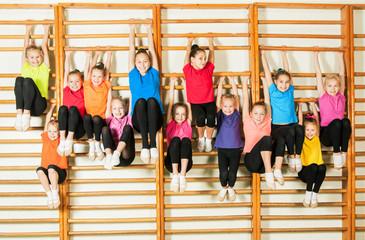 Happy sporty children in gym
