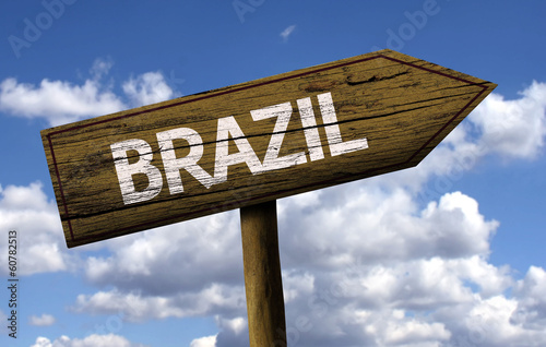 Brazil wooden sign with clouds as the background