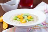 Oat porridge with fruit, orange, cumquat, kiwi, maple syrup