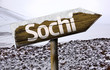 Sochi , Russia wooden sign with a snow background