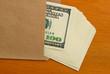 Dollars in an envelope.