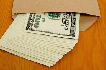 Dollars in an envelope.