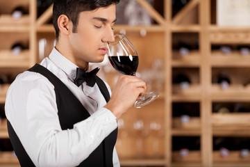 Tasting wine.