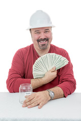 Happy construction worker holding-on to tax money