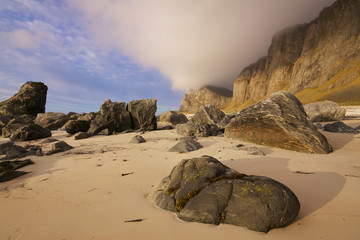 Boulders on sandy beach
