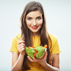 Woman diet concept portrait. Female model hold green salad.