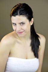 Beautiful smiling woman looking in studio