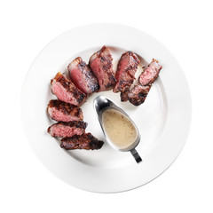 grilled steak on a plate (white background)