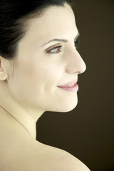 Profile portrait of woman with beautiful skin and green eyes