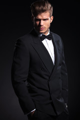 side view of a fashion man in tuxedo looking away