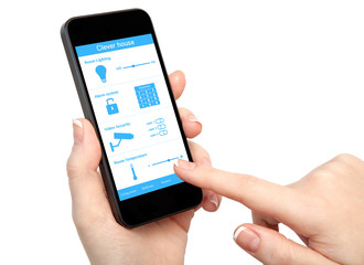 woman hand holding the phone with system clever house