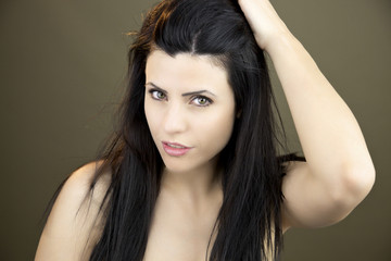 Woman touching long black hair