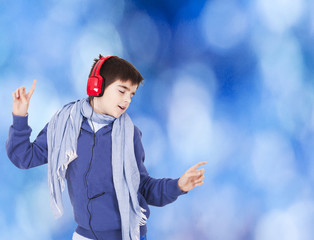 Young dancing with blue background and headphones