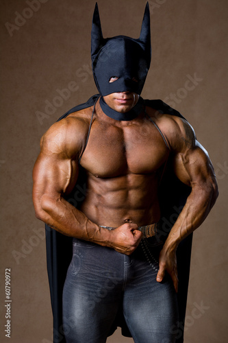 Handsome strong muscular man in black mask