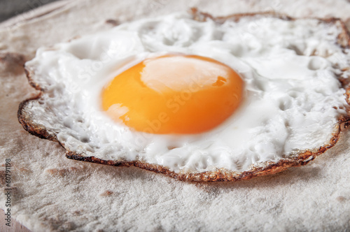 Fried egg on  grilled flour tortilla