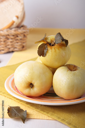 Pickled apples on a striped plate