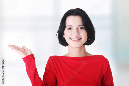 Woman presenting copy space on her palm