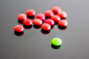 Pills on the black background