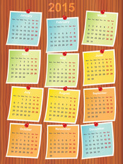 calendar 2015 on notes pinned to wood