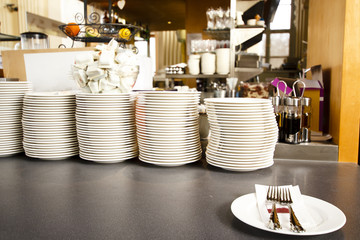 Pile of plates in the restaurant