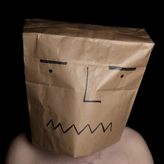 Man with paper bag in head