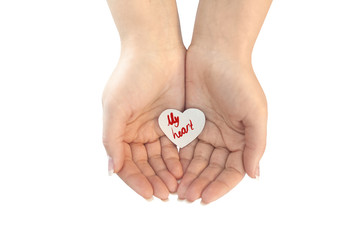 Paper heart protected in cupped hands