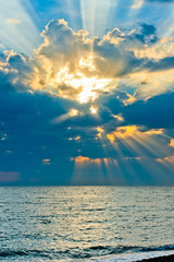 Vertical shot of a beautiful sky with sun rays