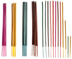 Colorful groups and individual incense sticks isolated