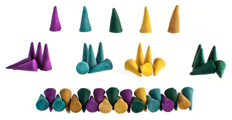 Colorful groups and individual incense cones on white background