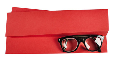 Vintage eyeglasses with black frame on red creative support