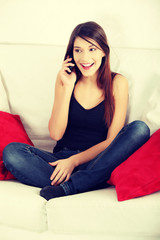 Beautiful young woman speaking by mobile phone