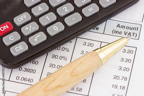 Invoice with calculator and pen