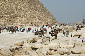 Tourists near famous Egyptian pyramids