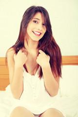 Beautiful woman on bed have fun