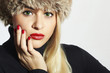 Beautiful Fashion Blond Woman in Fur. Beauty Girl. Red Manicure