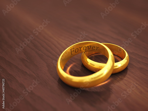 Engraved golden wedding rings , copyspace