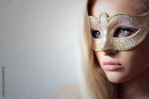 Beautiful Blond Woman in Carnival Mask.Masquerade.Close-up
