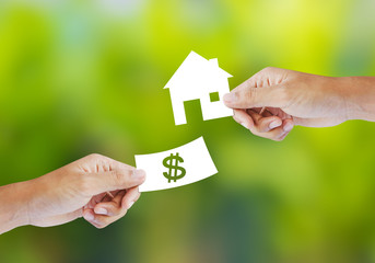 Hand with paper money and house shape. new house buy concept
