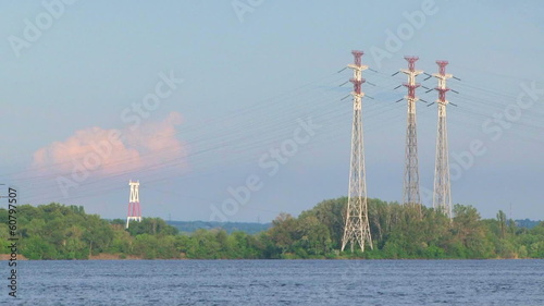 Power lines near a lake