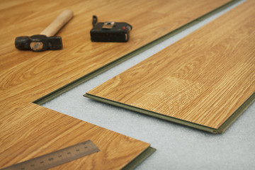 Laying  laminated panels the color of the wood