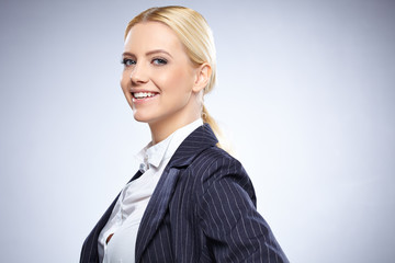 Portrait of beautiful business woman on gray background