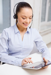 friendly female helpline operator with tablet pc