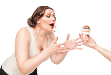 Beautiful plus size woman temptating with pastry