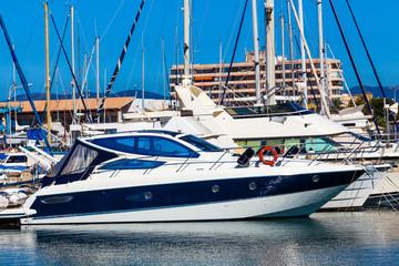 Yachts and boats anchored at a marina.  Sailing Boats