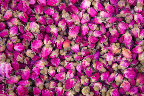 Dried rosebuds background texture closeup.