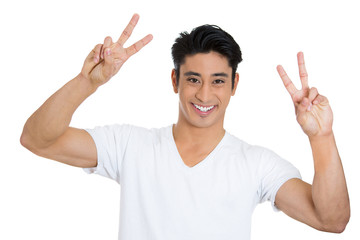 Happy, smiling young man holding up peace sign