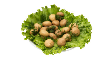 champignon mushrooms in lettuce leaves on a white background