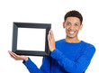 Confident handsome man holding picture frame on white